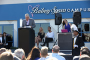 Clark County Commissioner Steve Sisolak (L) speaks as singer Britney Spears (C) and talent manager Larry Rudolph (3rd L)  look on during the grand opening of the Nevada Childhood Cancer Foundation Britney Spears Campus on November 4, 2017 in Las Vegas, Nevada.