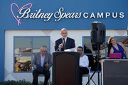 Nevada Childhood Cancer Foundation President and CEO Jeff Gordon (C) speaks as Clark County Commissioner Steve Sisolak (L) and talent manager Larry Rudolph (2nd R) look on during the grand opening of the Nevada Childhood Cancer Foundation Britney Spears Campus on November 4, 2017 in Las Vegas, Nevada.