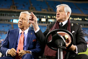 (L-R) Chairman and CEO Robert Kraft of the New England Patriots sits with owner/founder Jerry Richardson of the Carolina Panthers before the Patriots take on the Panters at Bank of America Stadium on November 18, 2013 in Charlotte, North Carolina.