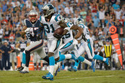 Charles Tillman #31 of the Carolina Panthers intercepts a pass from Tom Brady #12 of the New England Patriots during their preseason NFL game at Bank of America Stadium on August 28, 2015 in Charlotte, North Carolina.