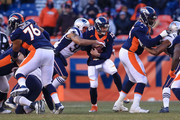 Quarterback Trevor Siemian #13 of the Denver Broncos is sacked by defensive end Jabaal Sheard #93 of the New England Patriots in the third quarter of a game at Sports Authority Field at Mile High on December 18, 2016 in Denver, Colorado.