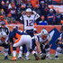 Tom Brady Photos - Quarterback Tom Brady #12 of the New England Patriots runs the offense against the Denver Broncos during a game at Sports Authority Field at Mile High on December 18, 2016 in Denver, Colorado. - New England Patriots v Denver Broncos