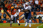 Tight end Dwayne Allen #83 of the New England Patriots misses what would have been a touchdown catch under coverage by defensive back Will Parks #34 of the Denver Broncos at Sports Authority Field at Mile High on November 12, 2017 in Denver, Colorado.
