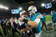 Brian Hoyer #2 of the New England Patriots congratulates  Jay Cutler #6 of the Miami Dolphins on their 27 to 20 win at Hard Rock Stadium on December 11, 2017 in Miami Gardens, Florida.