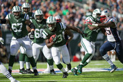 Running back Chris Ivory #33 of the New York Jets runs the ball in the 1st quarter against the New England Patriots at MetLife Stadium on October 20, 2013 in East Rutherford, New Jersey.