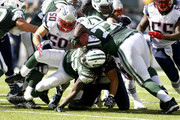 Rob Ninkovich #50 of the New England Patriots takes down Chris Ivory #33 of the New York Jets during their game at MetLife Stadium on October 20, 2013 in East Rutherford, New Jersey.