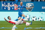 Marco Di Vaio #9 of the Montreal Impact looks on as his kick get deflected by A.J. Soares #5 of the New England Revolutionduring the MLS match at Saputo Stadium on October 27, 2012 in Montreal, Quebec, Canada.