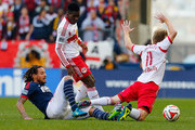 Dax McCarty #11 of New York Red Bulls is tripped up by Jermaine Jones #13 of New England Revolution during the Eastern Conference Final - Leg 1 at Red Bull Arena on November 23, 2014 in Harrison, New Jersey. Revolution defeated the Red Bulls 2-1.