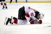 Marcus Johansson #90 of the New Jersey Devils slumps to the ice in the second period after getting injured against the New York Islanders during their game at Barclays Center on January 16, 2018 in the Brooklyn borough of New York City.