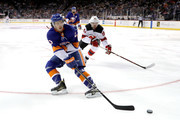 Mathew Barzal #13 of the New York Islanders skates with the puck against Marcus Johansson #90 of the New Jersey Devils in the first period during their game at Barclays Center on January 16, 2018 in the Brooklyn borough of New York City.