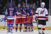 (L-R) Dan Girardi #5, Ryan Callahan #24, Brad Richards #19 and Carl Hagelin #62 of the New York Rangers celebrate Callahan's empty net goal against the New Jersey Devils at Madison Square Garden on February 27, 2012 in New York City.