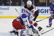 Henrik Lundqvist #30 of the New York Rangers makes the first period save on Marcus Johansson #90 of the New Jersey Devils at Madison Square Garden on September 24, 2018 in New York City.