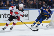 John Moore #2 of the New Jersey Devils handles the puck as Alexander Steen #20 of the St. Louis Blues pressures at Scottrade Center on January 2, 2018 in St. Louis, Missouri.