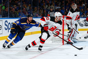 Marcus Johansson #90 of the New Jersey Devils controls the puck against Kyle Brodziak #28 of the St. Louis Blues at Scottrade Center on January 2, 2018 in St. Louis, Missouri.