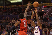 Michael Redd #22 of the Phoenix Suns attempts a three point shot over MarShon Brooks #9 of the New Jersey Nets during the NBA game at US Airways Center on January 13, 2012 in Phoenix, Arizona. The Nets defeated the Suns 110-103. NOTE TO USER: User expressly acknowledges and agrees that, by downloading and or using this photograph, User is consenting to the terms and conditions of the Getty Images License Agreement.