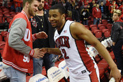 Washington Nationals right fielder and Major League Baseball 2015 National League Most Valuable Player Bryce Harper (L) greets Jerome Seagears #2 of the UNLV Rebels after the team defeated the New Mexico Lobos 86-74 at the Thomas & Mack Center on January 12, 2016 in Las Vegas, Nevada.