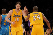 Pau Gasol #16 reacts with teammate Kobe Bryant #24 of the Los Angeles Lakers in the third quarter while taking on the New Orleans Hornets in Game Five of the Western Conference Quarterfinals in the 2011 NBA Playoffs on April 26, 2011 at Staples Center in Los Angeles, California. NOTE TO USER: User expressly acknowledges and agrees that, by downloading and or using this photograph, User is consenting to the terms and conditions of the Getty Images License Agreement.
