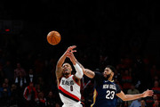 Anthony Davis #23 of the New Orleans Pelicans battles Damian Lillard #0 of the Portland Trail Blazers during Game One of the Western Conference Quarterfinals during the 2018 NBA Playoffs at Moda Center on April 17, 2018 in Portland, Oregon.  NOTE TO USER: User expressly acknowledges and agrees that, by downloading and or using this photograph, User is consenting to the terms and conditions of the Getty Images License Agreement.