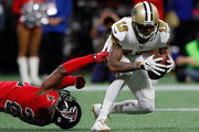 Ted Ginn Jr. #19 of the New Orleans Saints breaks a tackle by Keanu Neal #22 of the Atlanta Falcons at Mercedes-Benz Stadium on December 7, 2017 in Atlanta, Georgia.
