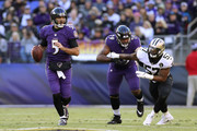 Quarterback Joe Flacco #5 of the Baltimore Ravens looks to throw the ball in the second quarter against the New Orleans Saints at M&T Bank Stadium on October 21, 2018 in Baltimore, Maryland.