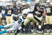 Josh Norman #24 of the Carolina Panthers tackles C.J. Spiller #28 of the New Orleans Saints during their game at Bank of America Stadium on September 27, 2015 in Charlotte, North Carolina.