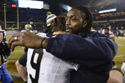 Charles Tillman #33 of the Chicago Bears hugs Drew Brees #9 of the New Orleans Saints after their game at Soldier Field on December 15, 2014 in Chicago, Illinois. The Saints defeated the Bears 31-15.