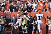 Jimmy Graham #80 of the New Orleans Saints catches a touchdown in front of Joe Haden #23 and Donte Whitner #31 of the Cleveland Browns during the second quarter at FirstEnergy Stadium on September 14, 2014 in Cleveland, Ohio.