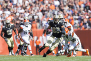 Tight end Jimmy Graham #80 of the New Orleans Saints caries the ball during the first half against the Cleveland Browns at FirstEnergy Stadium on September 14, 2014 in Cleveland, Ohio.