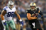 Jimmy Graham #80 of the New Orleans Saints carries the ball against Nick Hayden #96 of the Dallas Cowboys in the second half at AT&T Stadium on September 28, 2014 in Arlington, Texas.
