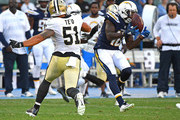 Manti Te'o #51 of the New Orleans Saints defends as Artavis Scott #10 of the Los Angeles Chargers hangs on to a pass in the second half of the preseason game at StubHub Center on August 25, 2018 in Carson, California.