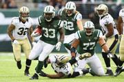Chris Ivory #33 of the New York Jets eludes the tackle of  David Hawthorne #57 of the New Orleans Saints during their game at MetLife Stadium on November 3, 2013 in East Rutherford, New Jersey.