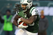Chris Ivory #33 of the New York Jets runs with the ball during their game at MetLife Stadium on November 3, 2013 in East Rutherford, New Jersey.