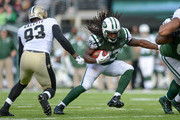 Running back Chris Ivory #33 of the New York Jets runs the ball  in the 2nd  quarter against the New Orleans Saints at MetLife Stadium on November 3, 2013 in East Rutherford, New Jersey.