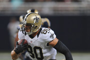 Jimmy Graham #80 of the New Orleans Saints rushes against Rodney McLeod Jr. of the St. Louis Rams after a first quarter catch in a preseason game at the Edward Jones Dome on August 8, 2014 in St. Louis, Missouri.