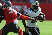 Running back C.J. Spiller #28 of the New Orleans Saints runs with the ball in the first quarter against the Tampa Bay Buccaneers at Raymond James Stadium on December 13, 2015 in Tampa, Florida.