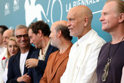 """(L-R) Maurizio Lombardi, Ludivine Sagnier, Massimo Ghini, Jude Law, Javier Cámara, John Malkovich and Ulrich Thomsen attend """"The New Pope"""" photocall during the 76th Venice Film Festival at Sala Grande on September 01, 2019 in Venice, Italy."""