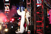 Miley Cyrus performs on stage ahead of midnight at The New Year's Eve 2014 Celebration in Times Square on December 31, 2013 in New York City.
