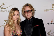 Model Natasha Poly and Design Peter Dundas attend The New York Ball: The 20th Anniversary Benefit For The European School Of Economics at Trump Tower on November 19, 2014 in New York City.
