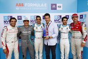 In this handout provided by FIA Formula E, Jérôme d'Ambrosio (BEL), Dragon Racing, Penske EV-2, Mitch Evans (NZL), Panasonic Jaguar Racing, Jaguar I-Type II, Sébastien Buemi (SUI), Renault e.Dams, Renault Z.E 17, Nicolas Prost (FRA), Renault e.Dams, Renault Z.E 17, and Daniel Abt (GER), Audi Sport ABT Schaeffler, Audi e-tron FE04, celebrate with the Pole Position award after qualifying during the New York City ePrix, Round 11 of the 2017/18 FIA Formula E Series on July 14, 2018 in New York, United States.