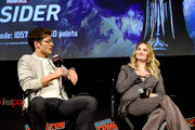 """Gregg Sulkin and Virginia Gardner speak onstage during the """"Marvel's Runaways"""" Panel at New York Comic Con 2019 - Day 2 at Hulu Theater at Madison Square Garden on October 04, 2019 in New York City."""