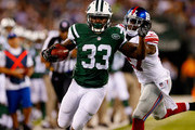 Chris Ivory #33 of the New York Jets runs the ball against Stevie Brown #27 of the New York Giants during a preseason game at MetLife Stadium on August 22, 2014 in East Rutherford, New Jersey.