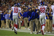 Eli Manning and Tom Coughlin Photos Photo
