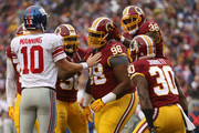 Defensive tackle Terrance Knighton #98, free safety Dashon Goldson #38 strong safety Kyshoen Jarrett #30 of the Washington Redskins react after a play while quarterback Eli Manning #10 of the New York Giants looks on in the first quarter at FedExField on November 29, 2015 in Landover, Maryland.