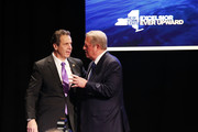 Former Vice President Al Gore (R) and New York Governor Andrew Cuomo stand on stage at an event at New York University, denouncing the Trump administration's proposal to open up new areas to offshore drilling, on March 9, 2018 in New York City. The two Democrats spoke on the negative environmental impact drilling, spills and underwater blasts could have on New York City.