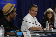 New York Governor Andrew Cuomo Is joined by Rosie Perez and Chris Rock at a press conference where the two performers helped to promote coronavirus testing, social distancing and the use of a face mask on May 28, 2020 in New York City.  The news conference was held at the Madison Square Boys and Girls Club in the Flatbush, Brooklyn neighborhood, one of the hardest hit by Covid-19 in New York City.