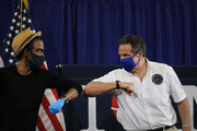 Actor Chris Rock  joins New York Governor Andrew Cuomo and Rosie Perez at a press conference where the two performers helped to promote coronavirus testing, social distancing and the use of a face mask on May 28, 2020 in New York City.  The news conference was held at the Madison Square Boys and Girls Club in the Flatbush, Brooklyn neighborhood, one of the hardest hit by Covid-19 in New York City.