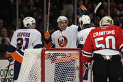 Kyle Okposo and Michael Grabner Photos Photo