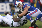 Kiko Alonso #50 of the Buffalo Bills tackles Chris Ivory #33 of the New York Jets during NFL game action at Ralph Wilson Stadium on November 17, 2013 in Orchard Park, New York.