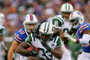 Chris Ivory #33 of the New York Jets is tackled by the Buffalo Bills at Ralph Wilson Stadium on November 17, 2013 in Orchard Park, New York. Buffalo won 37-14.
