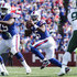 Tyrod Taylor Photos - Quarterback Tyrod Taylor #5 of the Buffalo Bills drops back to pass during the second half against the New York Jets on September 10, 2017 at New Era Field in Orchard Park, New York. - New York Jets v Buffalo Bills
